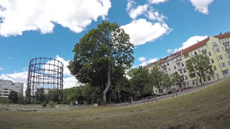 fish eye : BERLIN, GERMANY - JULY 1, 2018: Time Lapse: At The Gasometer in Berlin-Schoneberg