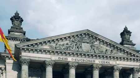 chancellor : German Politics Concept: The Reichstag Building in Berlin, Germany With Dedication Dem Deutschen Volke, Meaning To The German People, Zoom Out