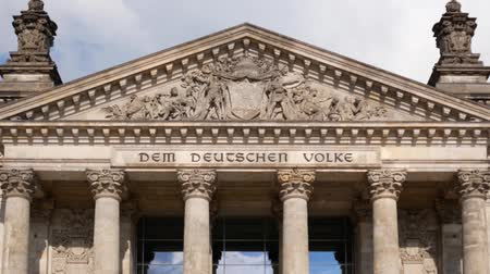 chancellor : Focus On German Politics Concept: The Reichstag Building in Berlin, Germany With Dedication Dem Deutschen Volke, Meaning To The German People, Zoom Out