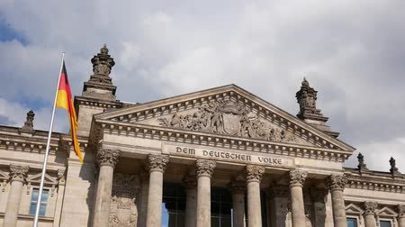 bundestag : German Politics Concept: The Reichstag Building in Berlin, Germany With Dedication Dem Deutschen Volke, Meaning To The German People