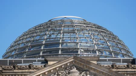 chancellor : BERLIN, GERMANY - AUGUST 6, 2018: Visitors In The Dome of The Berlin Reichstag Against A Blue Sky