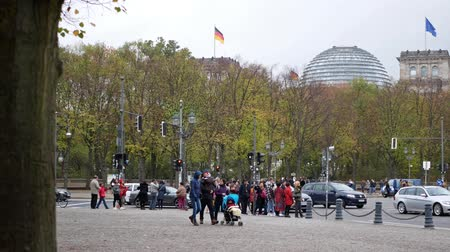 pan shot : BERLIN, GERMANY - OCTOBER 26, 2018: Pan Shot of Tourists And Traffic Near German Reichstag Building In Berlin, Germany
