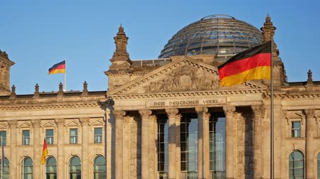 bundestag : BERLIN, GERMANY - OCTOBER 14, 2018: German Flags Fluttering In The Wind At The Reichstag Building In Berlin, Germany, Zoom Out