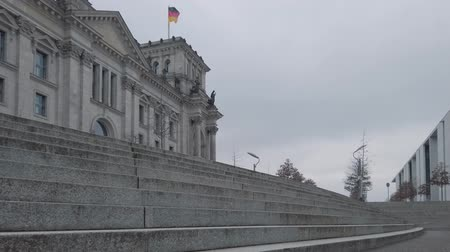 bundestag : The Reichstag Building Behind Stairs In Berlin, Germany In Winter