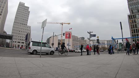 embassy : BERLIN, GERMANY - FEBRUARY 3, 2019: Time Lapse: People And Traffic At Famous Potsdamer Platz Square In Berlin In Winter Stock Footage