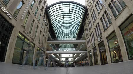 passerby : BERLIN, GERMANY - MAY 30, 2018: Fish-Eye Time Lapse: At The Entrance of Famous Shopping Mall Called LP12 Mall of Berlin In Berlin, Germany