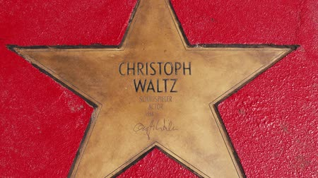 un : BERLIN, GERMANY - MAY 4, 2019: Star of Christoph Waltz At Boulevard der Stars, Walk of Fame In Berlin, Germany, Zoom Out