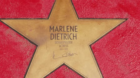 un : BERLIN, GERMANY - MAY 4, 2019: Star of Marlene Dietrich At Boulevard der Stars, Walk of Fame In Berlin, Germany, Zoom Out