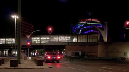 binnenstad : BERLIN, GERMANY - APRIL 21, 2019: Timelapse: Traffic At Metro Station Nollendorfplatz In Berlin, Germany At Night With Motion Blur, Pan Shot