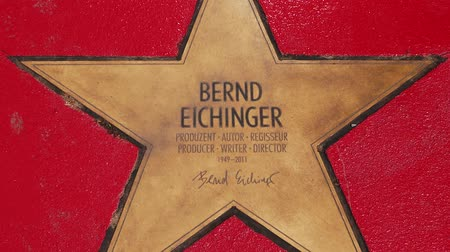 fama : BERLIN, GERMANY - MAY 4, 2019: Star of Bernd Eichinger At Boulevard der Stars, Walk of Fame In Berlin, Germany, Zoom Out Stock Footage