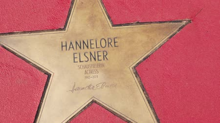 fama : BERLIN, GERMANY - MAY 4, 2019: Star of Hannelore Elsner At Boulevard der Stars, Walk of Fame In Berlin, Germany, Zoom Out Stock Footage