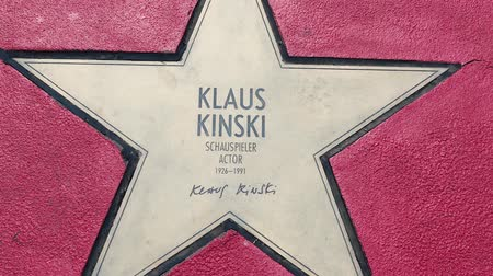 ator : BERLIN, GERMANY - MAY 4, 2019: Star of Klaus Kinski At Boulevard der Stars, Walk of Fame In Berlin, Germany, Zoom Out