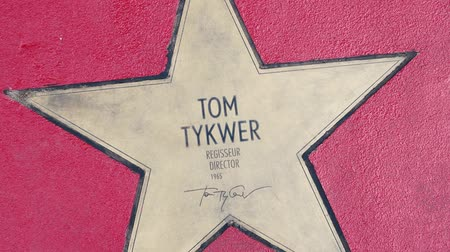 fama : BERLIN, GERMANY - MAY 4, 2019: Star of Director Tom Tykwer At Boulevard der Stars, Walk of Fame In Berlin, Germany, Zoom Out