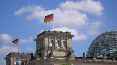 bundestag : Germany Flags And The Dome of The Reichstag Building in Berlin, Germany