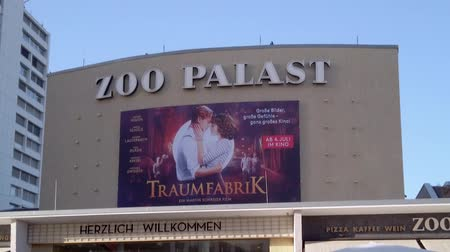 passerby : BERLIN, GERMANY - JUNE 29, 2019: At The Entrance of Famous Zoopalast Cinema In Berlin, Germany, Tilt Up Shot
