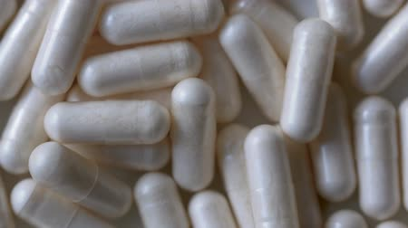 cápsula : Close-up of A Rotating Heap of Capsules, Pharmacy Background With Selected Focus Vídeos