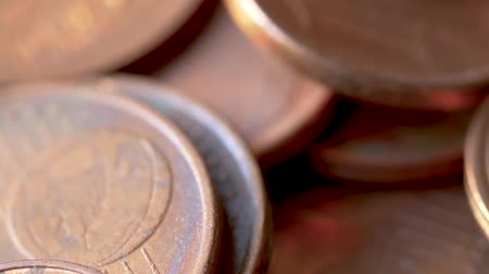 cent : Close-up of A Rotating Heap of Dusty And Dirty Bronze Euro Coins, Selected Focus, Blurry Background