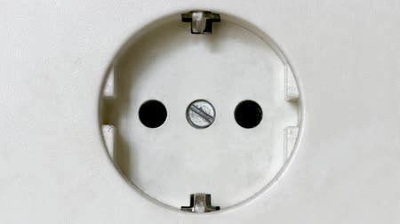 foglalat : Electricity Concept: White Power Socket, Fast Zoom Out Stock mozgókép