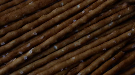 тощий : Close-up of A Rotating Heap of Salt Sticks, Food Background With Selected Focus, Zoom