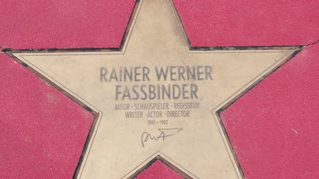 BERLIN, GERMANY - MAY 4, 2019: Star of Rainer Werner Fassbinder At Boulevard der Stars, Walk of Fame In Berlin, Germany, Zoom Out