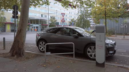 BERLIN, GERMANY - OCTOBER 6, 2019: Car At Charging Station For Electric Vehicles, Recharging Point of The City of Berlin