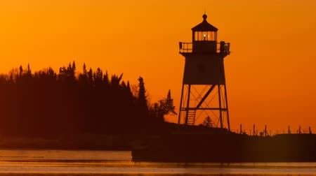 upper peninsula : Morning Light Harbor Grand Marais Lighthouse Lake Superior Minnesota USA Stock Footage