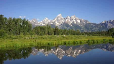 grand tetons : Smooth Water Reflecting Mountains Grand Teton National Park Stock Footage