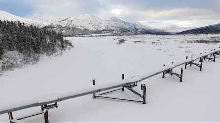 tubular : Oil Transport Alaska Pipeline Cuts Across Rugged Mountain Landscape