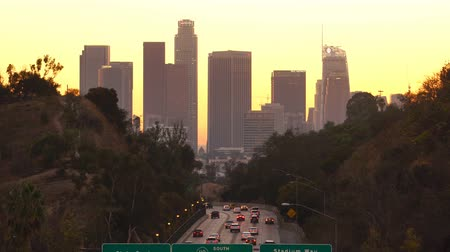 vanish : Los Angeles Freeway Commuters in Automobiles Backlit Highway Stock Footage