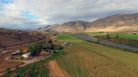 Aerial Perspective over Farmland Near the Okanogan River in Washington State Stok Video
