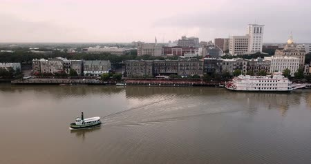 ga : Ferry Boats Move Across the Savannah River from Downtown