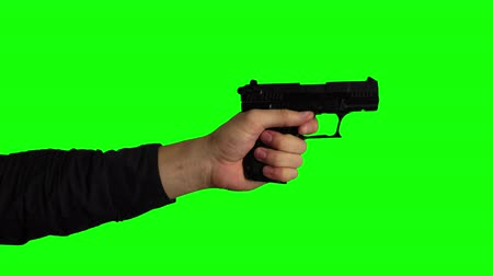 петух : Slow Motion Hand Firing Gun on Chroma Key Green Screen Background Стоковые видеозаписи