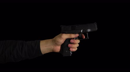 matança : Slow Motion Hand Firing Gun on Transparent Background Stock Footage