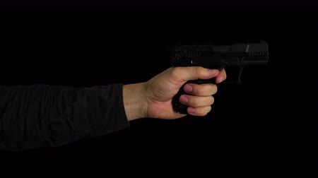 пистолеты : Hand Firing Gun on Transparent Background Стоковые видеозаписи