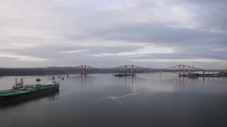 süspansiyon : Three bridges, Forth railway Bridge, Forth Road Bridge and Queensferry Crossing, over Firth of Forth near Queensferry in Scotland have been build in three centuries: 19th, 20th and 21st. Stok Video