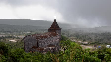 кхмерский : Abandoned christian church on top of Bokor mountain in Preah Monivong national park, Kampot, Cambodia Стоковые видеозаписи