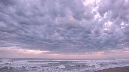 bulutluluk : Cloudy seascape view in Viareggio, Tuscany, Italy Stok Video