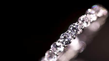 rombusz : Engagement diamond ring rotating on black background, macro with shallow DoF