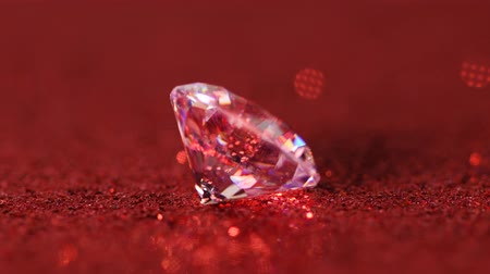 faceta : Large diamond rotating on red shiny background, macro 4k , looped Stock Footage