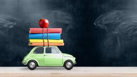 papeteria : Back to school looped 4k animation. Car delivering books and apple against school blackboard. Car is moving from left to right. Wideo