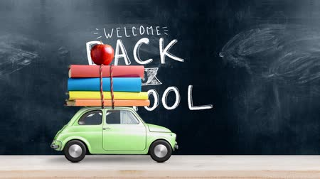 miniatűr : Back to school looped 4k animation. Car delivering books and apple against school blackboard with education symbols. Car is moving from left to right.