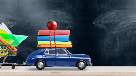 ders kitabı : Back to school. Car delivering books, shopping cart with stationery and apple against school blackboard with education symbols. Car is moving from left to right. Seamlessly looped 4k animation