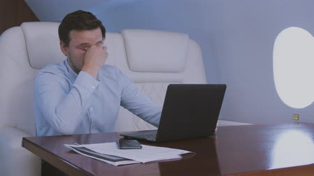 Businessman tired after hard laptop work and go to sleep during trip on private business jet. Stock Footage