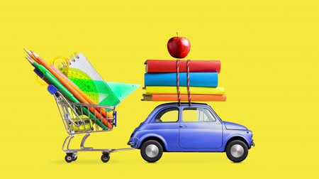 Back to school. Car delivering shopping cart with stationery, books and apple against yellow colored school blackboard . Seamlessly looped 4k animation. Wideo