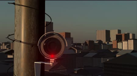 rioting : View over a city and up to and into the lens of a CCTV Camera. Stock Footage