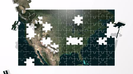 puzle : Pieces of a puzzle fly in and assemble to create a map of the United States. Wideo