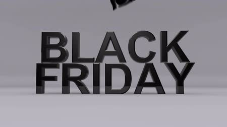 czarne : Satin black cloth is lifter up to reveal the text Black Friday.
