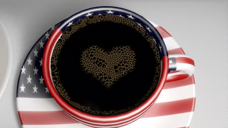feketés csésze : Coffee bubbles pop to reveal heart in a cup with USA flag and a large Donut
