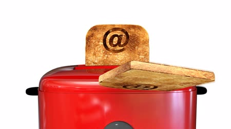 yanmış : Red toaster pops up with 2 slices of toast with an email at sign(@)burnt on them Stok Video