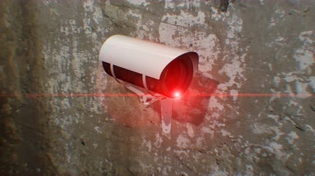 rioting : Close up on a security camera attached to a wall. The Security Camera pans left Stock Footage